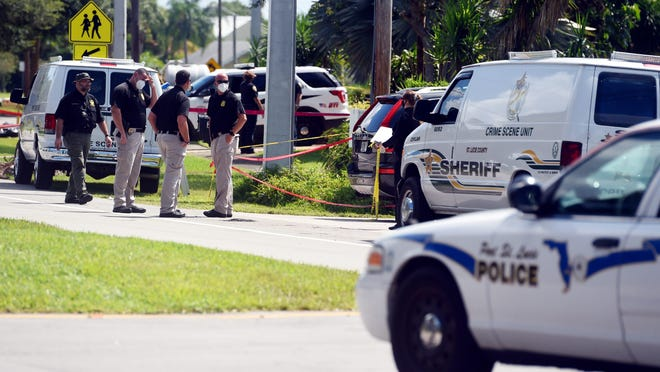 Port St. Lucie police and St. Lucie County Sheriff's officials continue working the scene of a shooting in the 2500 block of Southeast  Morningside Boulevard in Port St. Lucie on Tuesday, July 7, 2020, were three people, including a teen girl, died the day before. The incident appeared to stem from a neighborhood dispute over a dog.  Tcn Shooting Folo