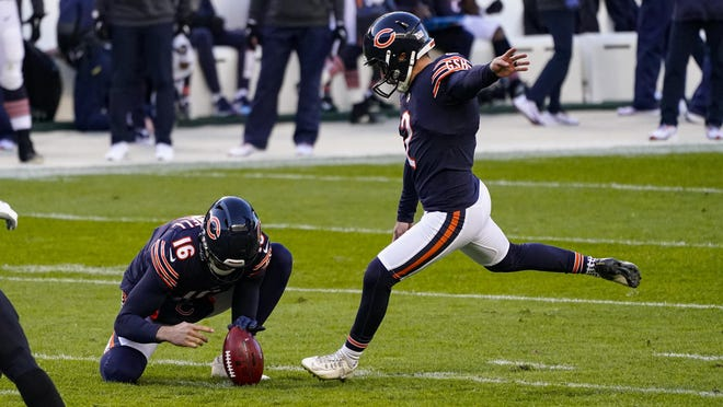 Chicago Bears kicker Cairo Santos (2) kicks a field goal from the hold of Pat O'Donnell in the first half of an NFL football game against the New Orleans Saints in Chicago, Sunday, Nov. 1, 2020.