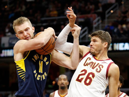 Pacers forward Domantas Sabonis (11) fights for the