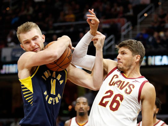 Pacers forward Domantas Sabonis (11) fights for the ball against Cleveland Cavaliers guard Kyle Korver (26) during the second quarter at Quicken Loans Arena.