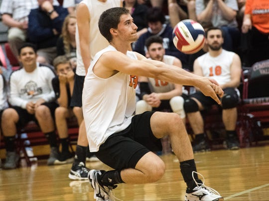 Palmyra's Ryan Betz passes the ball, Tuesday, June 5, 2018. The Northeastern Bobcats beat the Palmyra Cougars in three sets to advance to the PIAA Class 2A finals. Tuesday, June 5, 2018. The Northeastern Bobcats beat the Palmyra Cougars in three sets to advance to the PIAA Class 2A finals.