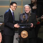 Acting Librarian of Congress David Mao presents Willie Nelson with the 2015 Library of Congress Gershwin Prize for Popular Song on Wednesday, Nov. 18, 2015, in Washington.