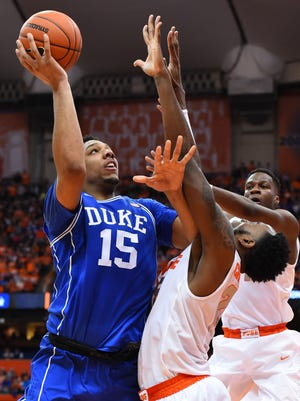 Duke Blue Devils center Jahlil Okafor goes in against Syracuse Orange forward Rakeem Christmas.