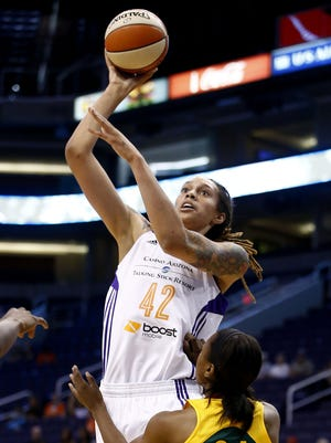 Phoenix Mercury center Brittney Griner looks to the basket and scores over Seattle Storm guard Jewell Loyd during WNBA preseason action on Thursday, May 28, 2015, at US Airways Center in Phoenix, AZ.