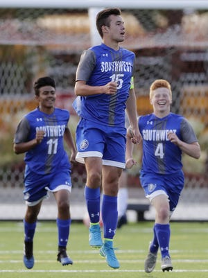 Green Bay Southwest's Harrison Curran (15) celebrates after scoring a goal against Green Bay East earlier this season.