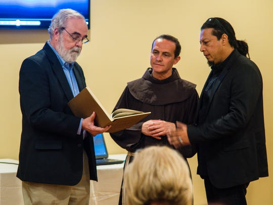 Gus Clemmons presents a book about the Councho Valley to the Rev. Stefano M. Cecchin, at a reception at Bentwood Country Club August 8, 2017.