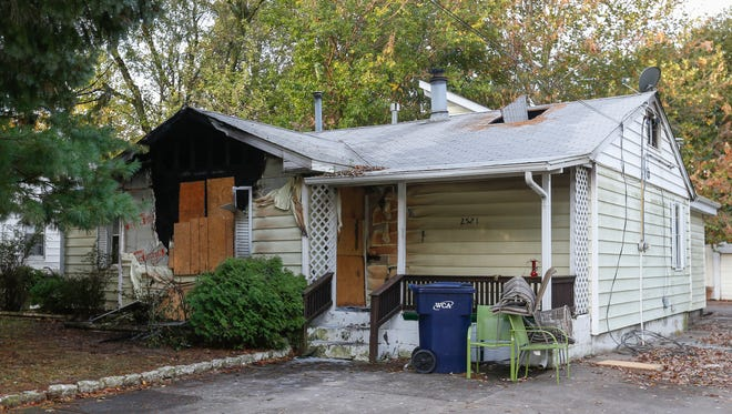 Officials say a woman died in a house fire late Wednesday night in north Springfield.