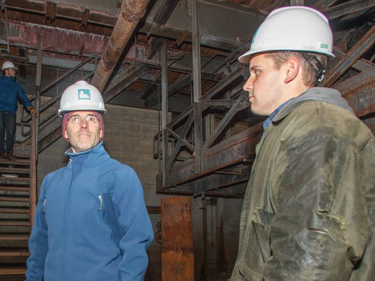 Charlie Tipper and Erick Crockenberg, who plan to redevelop the Moran plant with teammate Tad Cooke (not pictured), give a tour of the building on Monday.