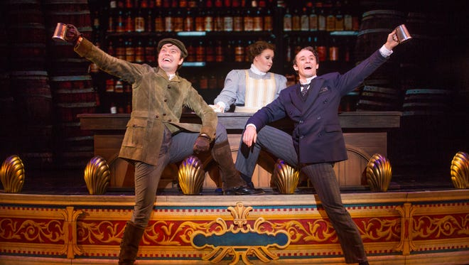 "James Taylor Odom (left) and Blake Price celebrate as Kristen Kane tends bar in ""A Gentleman's Guide to Love & Murder."" The touring Broadway musical visits Milwaukee's Marcus Center for shows May 1-6."