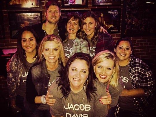 The Jacob Davis Squad fan club pose with Jacob Davis