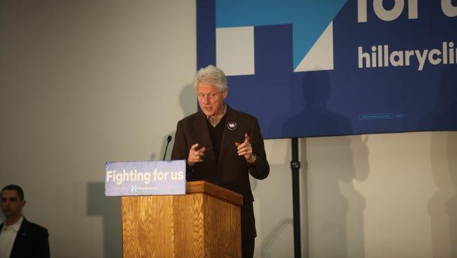 Former President Bill Clinton talks to voters about his wife, Hillary, in Marshalltown Friday.