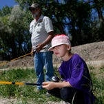 Aztec kindergartners learn to fish in fourth annual field trip