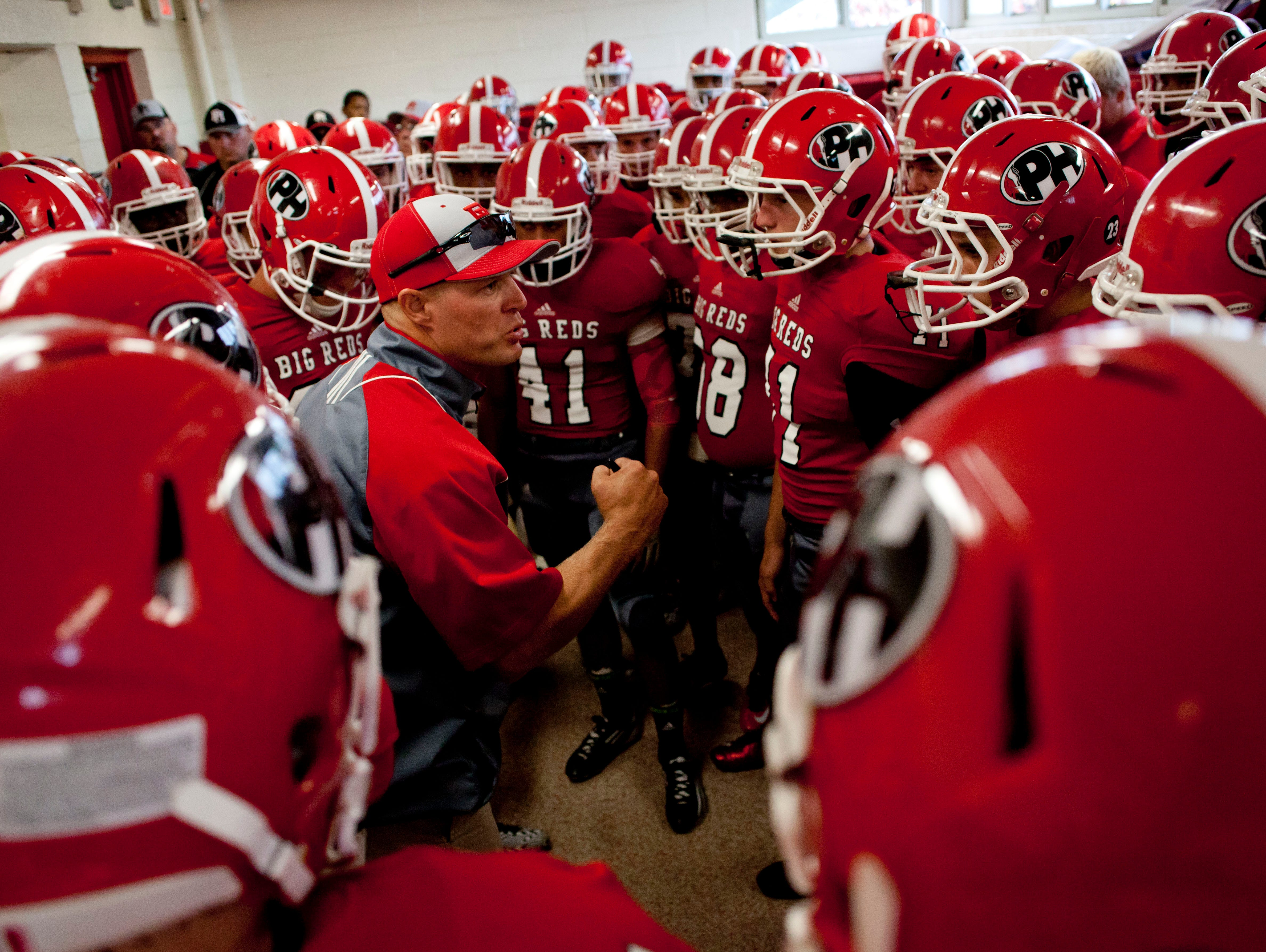 Port Huron coach Ryan Mullins talks to players in the locker room during a football game August 29, 2014 at Port Huron High School.