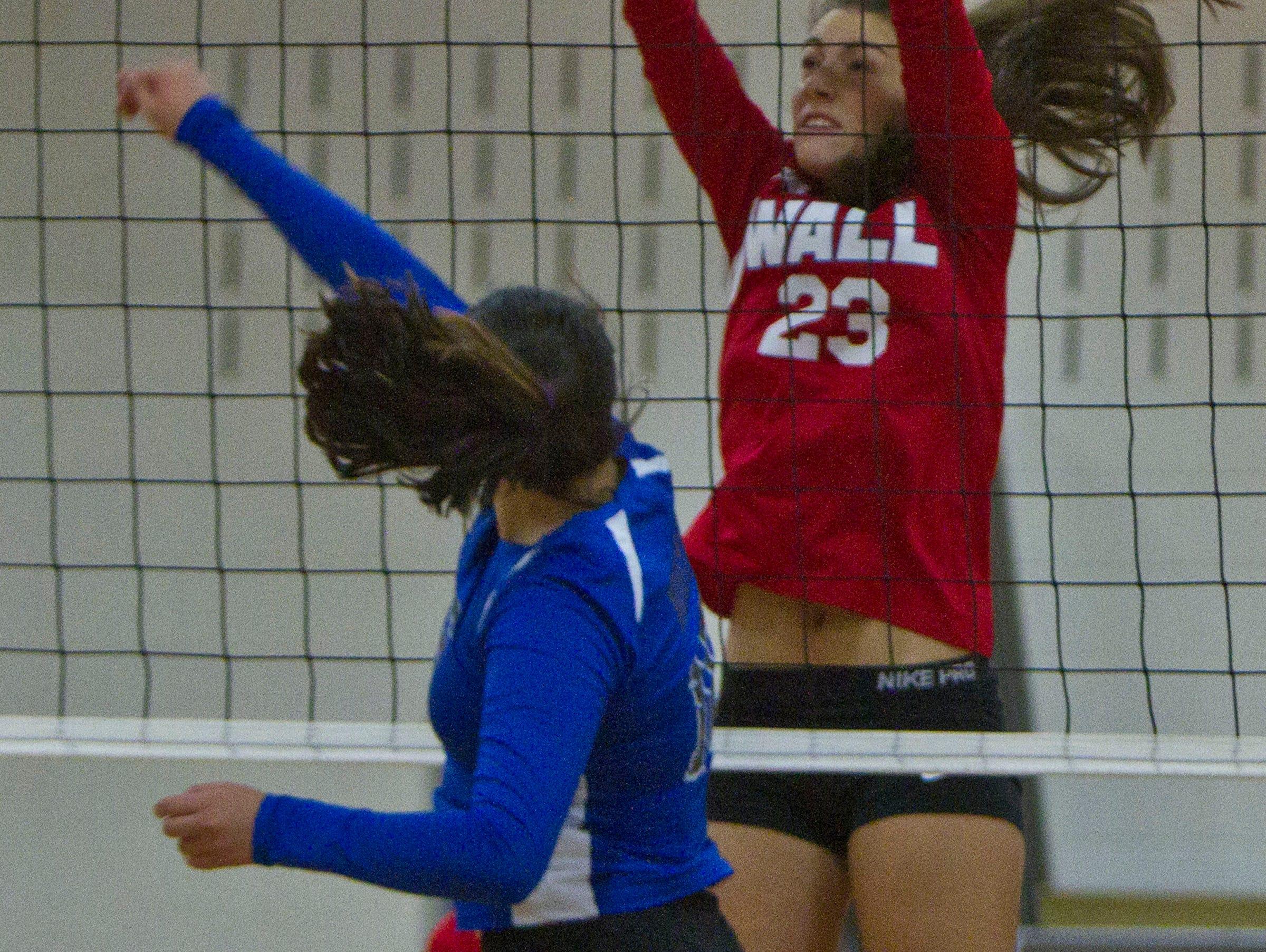 Wall's Tara Casuccio blocks a shot by Windsor's Carolyn Vaca. NJSIAA volleyball match between Wall and West Windsor Plainsboro North. Wall Township, NJ Wednesday, November 4, 2015 @dhoodhood