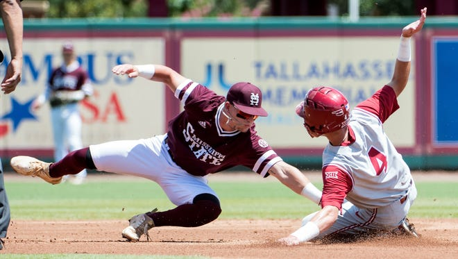 Mississippi State shortstop Luke Alexander attempts to tag Oklahoma's Brandon Zaragoza at second base Friday during their opening game at the NCAA Tournament Tallahassee Regional.