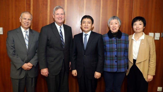 From left, Jaime Castaneda, USDEC senior vice president; Tom Vilsack, USDEC president and CEO; Li Chenggang, assistant minister of commerce in China; Madam Yu Lu, China Chamber of Commerce for Import and Export of Foodstuffs and Native Produce, and Chang Su, of USDEC's China office.