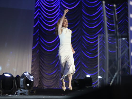 Holly Hunter leaps into the air as she walks on stage