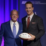 Former Indianapolis Colts Peyton Manning poses for a photo with Cotls owner Jim Irsay following a press conference Friday, March 18, 2016, at the Colts complex.
