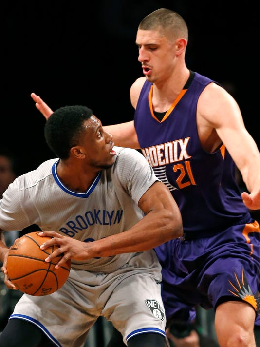 Phoenix Suns center Alex Len (21) defends Brooklyn Nets forward Thaddeus Young in the first half of an NBA basketball game at the Barclays Center, Tuesday, Dec. 1, 2015, in New York. (AP Photo/Kathy Willens)