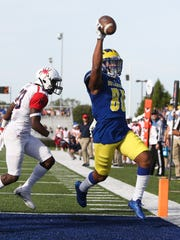 Delaware receiver Diante Cherry gets into the end zone