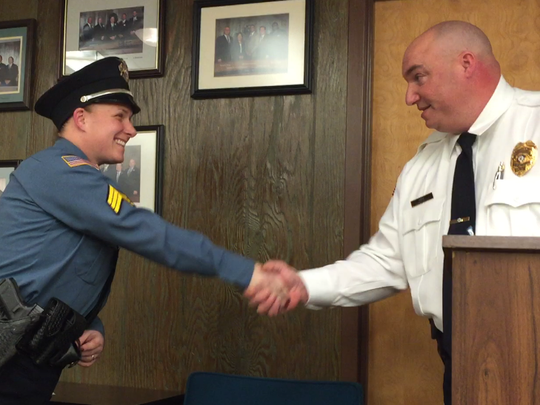 Police Chief Jody Farabella congratulates Sgt.. Cindi Zadroga during her promotion ceremony at Tuesday night's City Commission meeting.