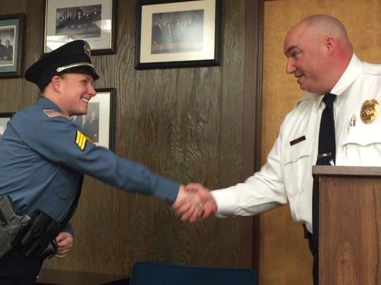 Police Chief Jody Farabella congratulates Sgt.. Cindi
