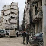 A building is seen with heavy damage in Aleppo, Syria. The fighting has brought government forces closer to the Turkish border.