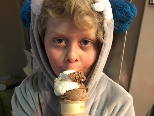 Brody Capra, 8, eats ice cream. His mom Wendy Capra