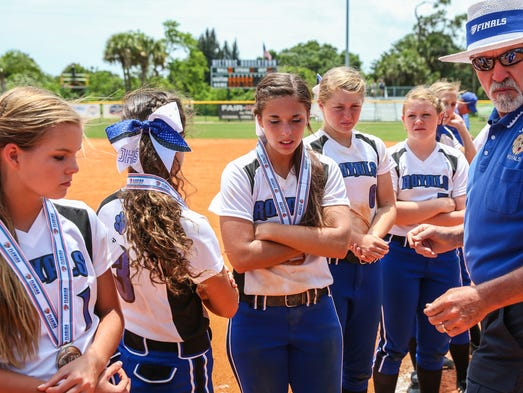 J. PATRICK RICE / SPECIAL TO NEWS JOURNAL Jay Royals (L-R) Miranda Roberts, Michaela Stewart, Emily Dobson, Harley Tagert and  Holley Fugatt sadly receive their state runner up medals at the 2014 FHSAA Class 1A Championship game against Chiefland High School played at Historic Dodgertown in Vero Beach on Saturday, May 10, 2014.