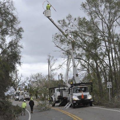 Gulf Power crews work along Scenic Highway. Retirees