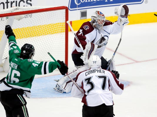 Dallas Stars center Gemel Smith (46) and Colorado Avalanche left wing JT Compher (37) watch as goalie Calvin Pickard (31) reaches up with his glove to make a save in the third period of a preseason NHL hockey game, Wednesday, Oct. 5, 2016, in Dallas. The Avalanche won 1-0. (AP Photo/Tony Gutierrez)