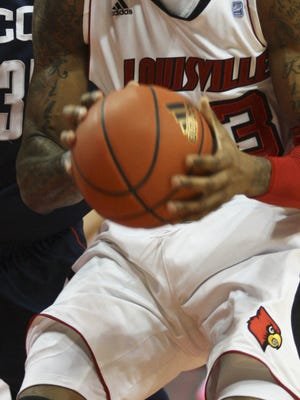 The FBI announced charges of fraud and corruption in college basketball, and references a public research university in Kentucky that fits the description of the University of Louisville.
