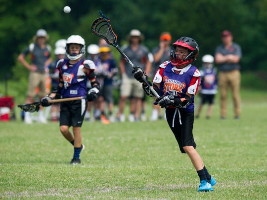 Eville Storm 12U's Wendy M. passes the ball during the 2018 Thunderbolt Shootout on Sunday, June 10, 2018.