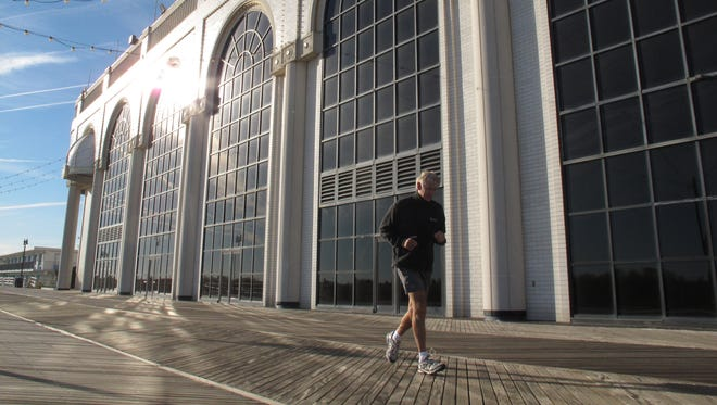 A jogger runs past the Atlantic Club Casino Hotel in Atlantic City, which will be shuttered in January.