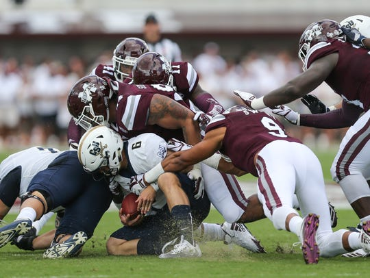 Mississippi State's Montez Sweat (9) and Mississippi