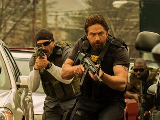 "Gerard Butler stars in ""Den of Thieves,"" playing at"