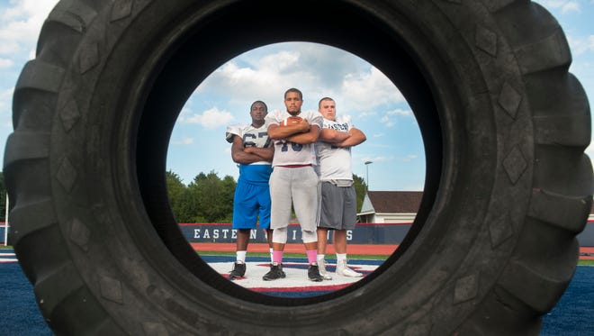Portrait of Eastern football players,  l-r,  senior Jamir Wilson (defensive end/offensive guard), senior Zach White (tight end/linebacker), and senior Cade Regn (tackle).  08.15.16