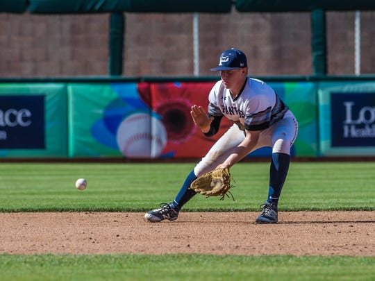 Piedra Vista shortstop Cody McGaha fields a grounder against Cleveland on Friday at Isotopes Park in Albuquerque.