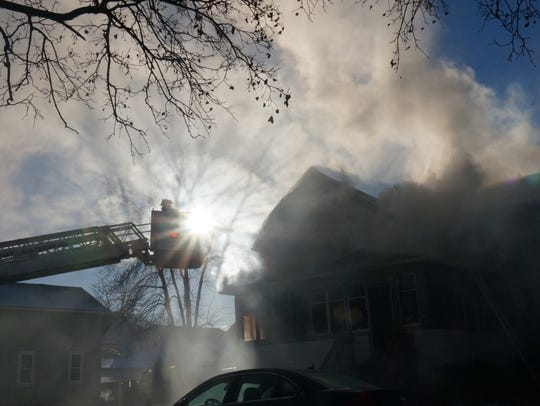 Smoke billows from 180 Ledgeview Ave. this morning