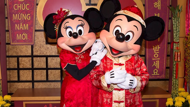 This January 2016 image provided by Disneyland Resort shows Mickey Mouse and Minnie Mouse dressed in red for a Lunar New Year celebration at Disney California Adventure Park in Anaheim, Calif. The park will celebrate year of the rooster this year from Jan. 20 through Feb. 5 with live performances, activities, decor, special food and Disney characters dressed for the Lunar New Year holiday.