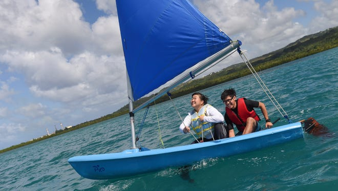 Pacific Daily News reporter Sue Lee expresses her joy of sailing with Jeremy Del Castillo during the Marianas Yacht Club Challenge Day at Sasa Bay, Piti on Nov. 27, 2016.