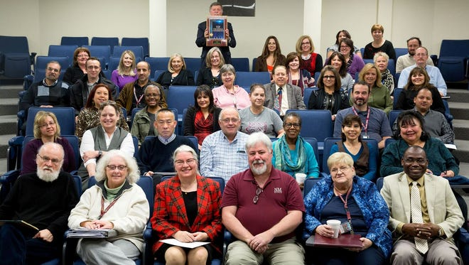 NMSU Carlsbad faculty and staff posed with their newest award.