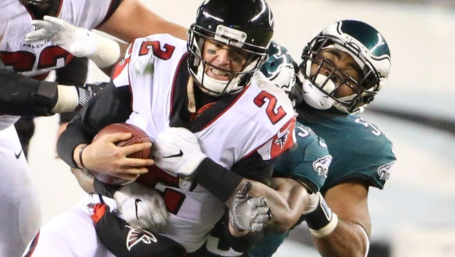 Atlanta quarterback Matt Ryan is sacked by Philadelphia's Nigel Bradham (obscured) and Brandon Graham in the Eagles' 15-10 win in a NFC Divisional Playoff at Lincoln Financial Field Saturday.