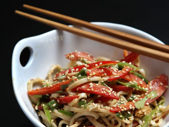 Udon noodle salad with red peppers, snow peas, enoki
