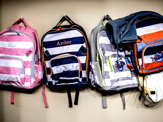 Before the kids arrived in Ohio, Caity got each of them backpacks with their names monogrammed on the front. It was a bit of an extravagance Caity admitted, but worth it to make them feel at home.