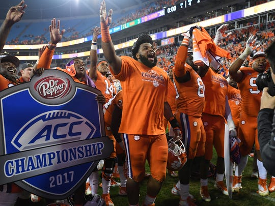 Clemson defensive lineman Christian Wilkins (42) celebrates after the Tigers 38-3 win over Miami in the ACC championship game at Bank of America Stadium in Charlotte on Saturday, December 2, 2017.