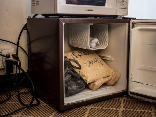 The only refrigeration space in the motel room, for Janine Horne and Tim Bixler to use to keep their food cold. The couple recently had to move into the Knights Inn in Heath after losing their home a few months previous.