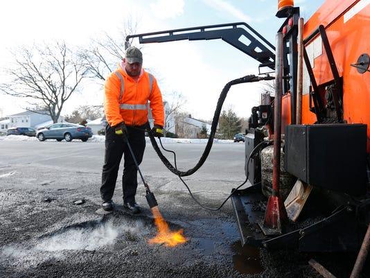 Paving potholes
