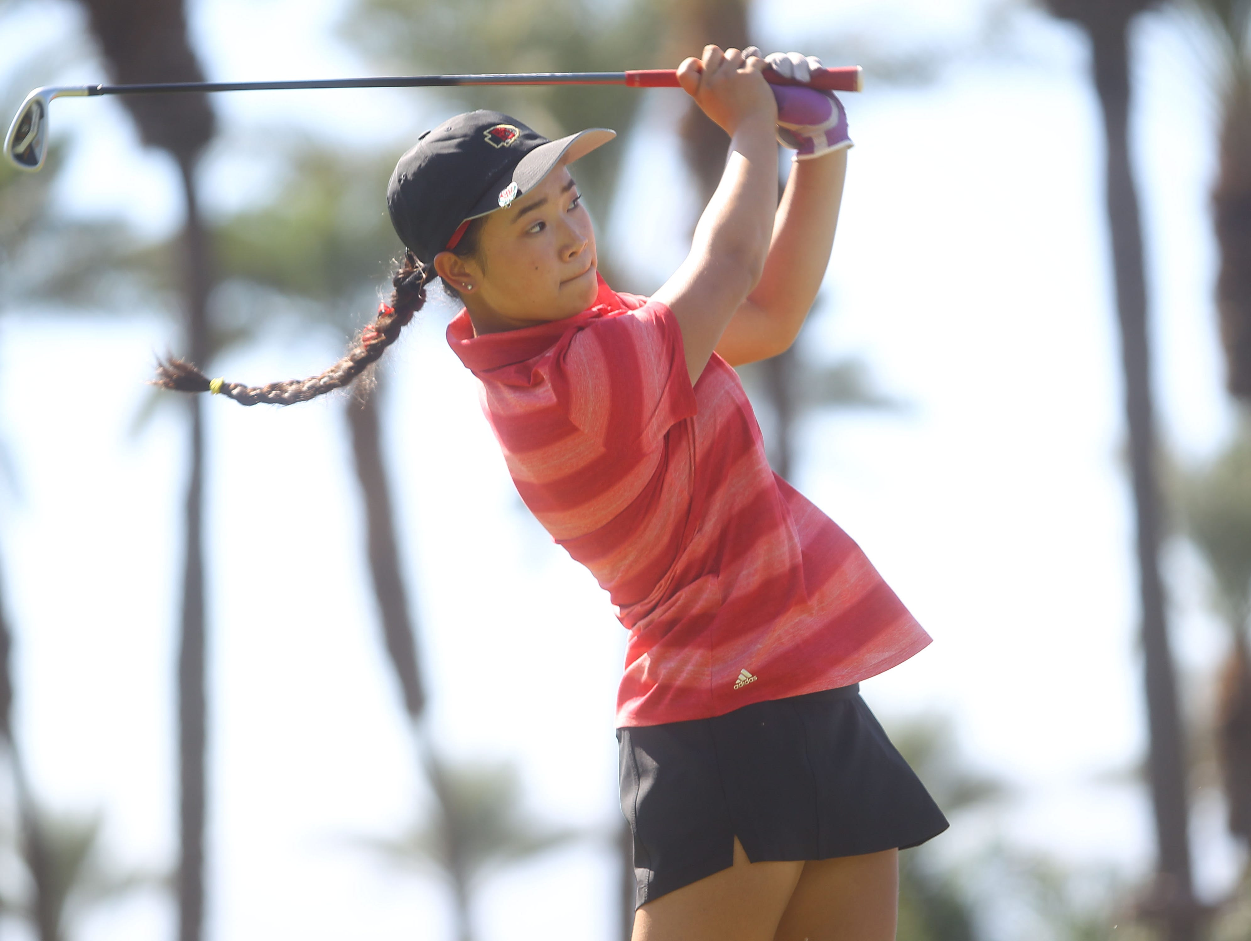 Palm Desert High School's Madison Walker tees of on the 3rd tee during her school's match against Xavier Prep at JW Marriott Desert Springs Resort in Palm Desert.