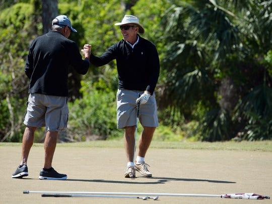 Steve Engel (left) gives Nick Harvey a fist-bump after